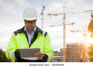 Construction engineer wearing safety vest