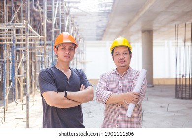 construction engineer who looks after the progress of a construction project stands on the concrete floor.