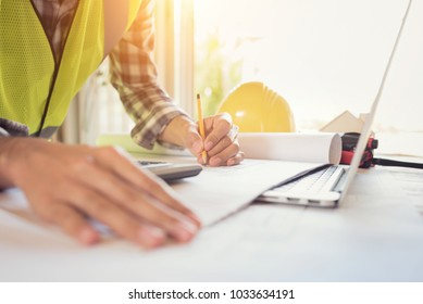 Construction engineer working Planning for a New Project on table in meeting room
