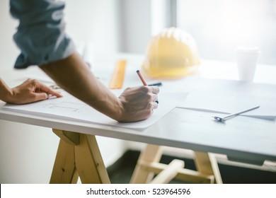 Construction engineering. Architect hands on desk
