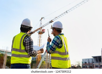 Construction engineers discussion with architects at construction site or building site of highrise building with Surveying for making contour plans is a graphical representation of the lay in land.
