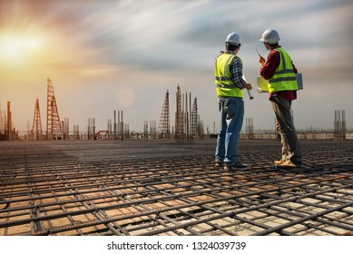 Construction engineers discussion with architects at construction site or building site. Consultant in construction site jobs concept.