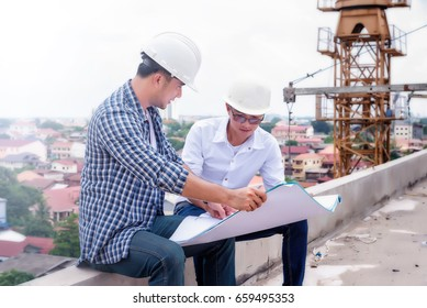 Construction engineers are looking at the plan.