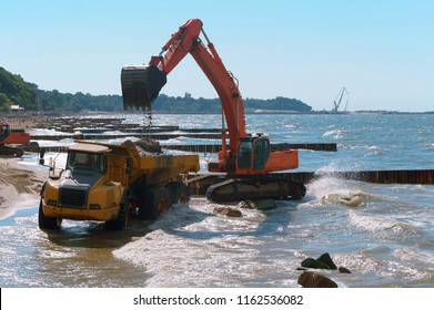 construction equipment on the shore, the construction of breakwaters, coastal protection measures