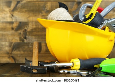 Construction equipment on wooden background