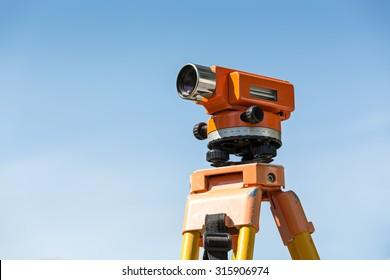 construction equipment theodolite level tool against blue sky