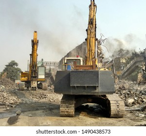 Construction equipment is used at a large demolition project
