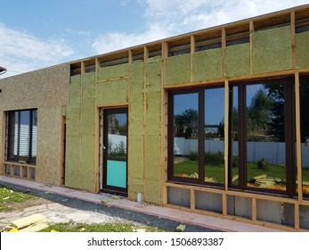 Construction of external wall thermal insulation with rock wool. Exterior passive house wall heat insulation with mineral wool. Insulation the facade of commercial building.