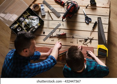 construction of father and son in the garage, family concept  view from above on the desktop with tools
