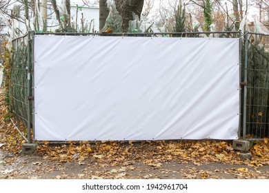 Construction fence with space for banner advertising - Shutterstock ID 1942961704