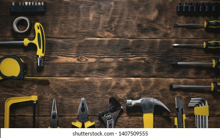 Construction flat lay background with copy space. Work tools on a wooden workbench.