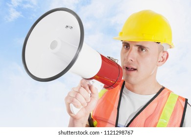 Construction foreman outdoors giving orders on megaphone