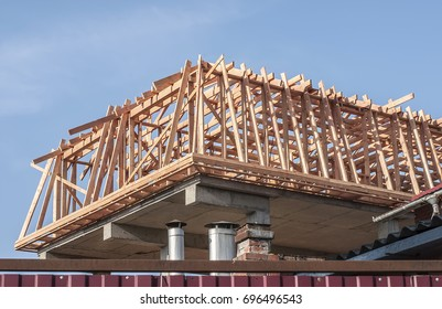 the construction of the frame of the attic of the wooden beams.