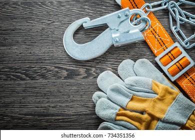 Construction gloves safety strap on vintage wooden board.