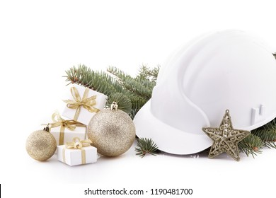 Construction hard hat, fir tree branches and Christmas decoration isolated on a white background. New Year and Christmas.