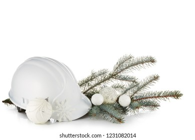 Construction hard hat, fir tree branches and Christmas ornament isolated on a white background. New Year and Christmas. Horizontal view.