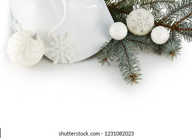 Construction hard hat, fir tree branches and Christmas ornament isolated on a white background. New Year and Christmas. Top view with copy space