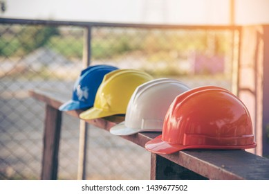 Construction hard hat safety tools equipment for workers in construction site for engineering protection head standard. Many hard hat helmet on row with copy space. Engineering Construction Concept