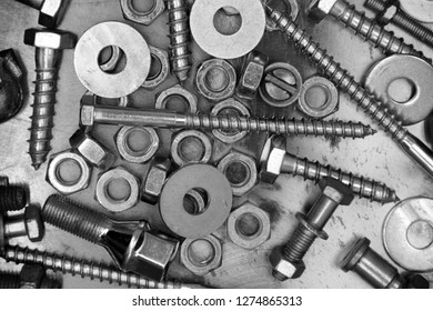Construction hardware background. Bolts and nuts on metal background
