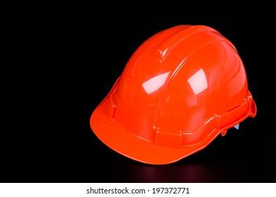 Construction hat on black background
