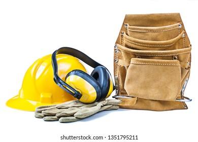 construction helmet gloves earphones leather toolbelt isolated on white