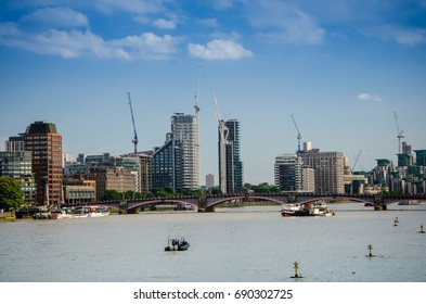 Construction high building with crane through  the Thames River at Central London. Financial district , business city and shipment transportation ,United Kingdom.