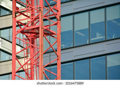 Construction of high-rise office center with modern technology. Fragment of a building on a light background of the sky.