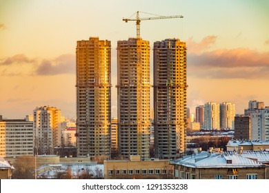 Construction of high-rise residential buildings in the big city. Winter cityscape at sunset . Moscow, Russia.
