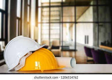 Construction house and building. Repair work. Drawings for building and helmet on white table.