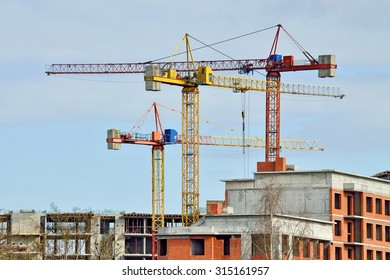 Construction house and crane against of blue sky