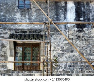 Construction of a house with the help of bamboo scaffolding, Tongli, China
