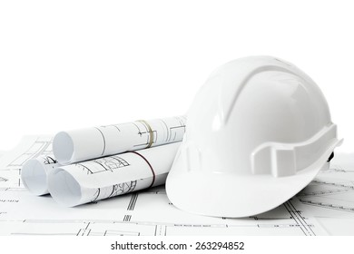Construction house. Repair work. Drawings for building and helmet on white a background.
