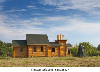 Construction of houses from cylindrical wooden logs