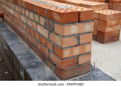 Construction of houses, masonry walls made of red bricks and cement