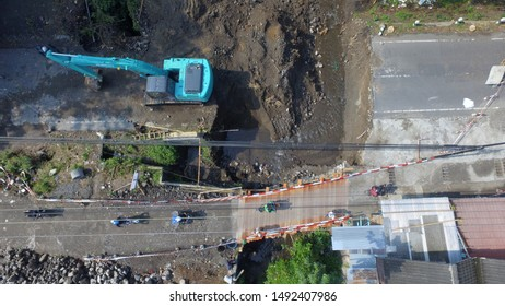 construction and improvement of roads as transportation infrastructure in Indonesia and Asia. The excavator is dredging the ground.