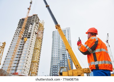 Construction industrial worker operating tower crane installation