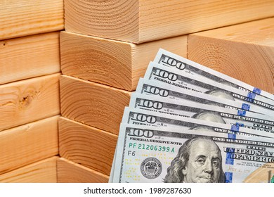 Construction lumber with cash money. Building materials price increase, home construction and remodeling cost concept.