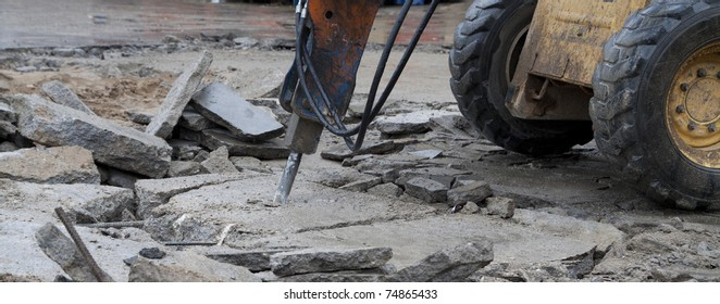 Construction machinery with jackhammer. Demolition work