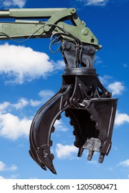 construction machinery parts on blue sky background. Heavy lifting crane equipment for the forest industry