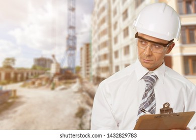 Construction man Inspector Safety Glasses on building background