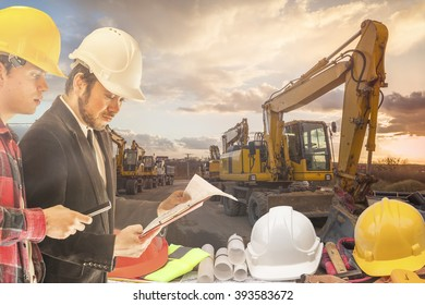 Construction manager on the construction site at sunset as background Construction