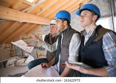 Construction manager with workers checking on site