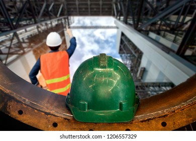 Construction managers and engineers working in buildings. Engineer working in a thermal power plant with talking on the walkie-talkie for controlling work
