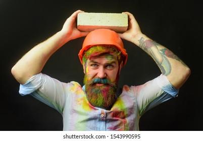 Construction mason worker bricklayer. Man builder bricklayer in orange helmet. Civil engineer. Prevent accident. Safety helmet. Prevent injury. Accident prevention. Safety at any time. Safety concept.