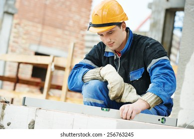 construction mason worker bricklayer working level levelling bricks