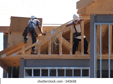 Construction men working on roof