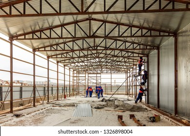 Construction of metal hangar or shed. Frame walls and roof on construction site. In engineering, truss is structure consists of two-force members. Prefabrication is practice assembling. Moscow 02/2019