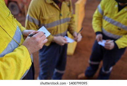 Construction miner workers conducting self risk assessment call as take five step prior to work of each task