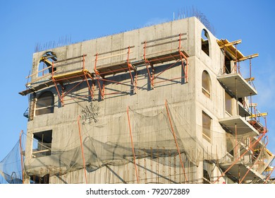 Construction of multi-storey monolithic house. Facade of new multi-apartment building.