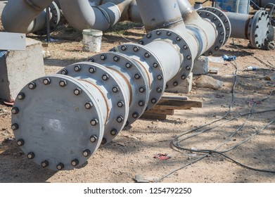 Construction of a new energy pipeline underway.The welding on the oil transmission pipeline in the field.Weld pipe joints made by manual arc welding.oil and gas pipes flange with the  stud and bolt.